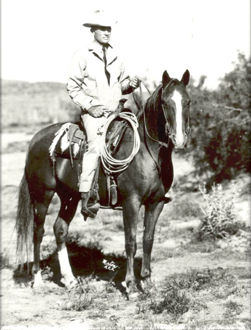 AQHA Past President Albert K. Mitchell sits aboard a sorrel horse with a white blaze