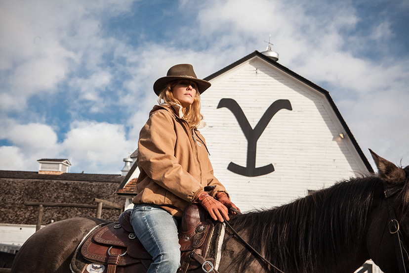 Kelly Reilly, who plays Beth Dutton, sits astride a horse