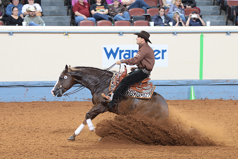 Andrea Fappani does a sliding stop on Lil Joe Cash en route to the junior reining world championship at the 2012 AQHA World Show