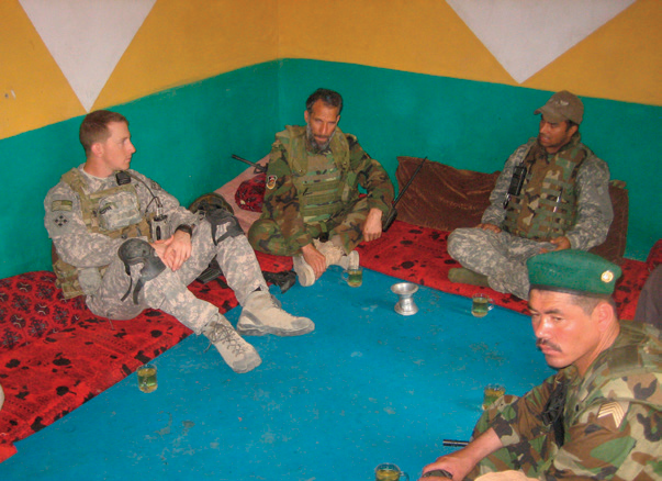 Taylor Gillespie meets with village elders in Afghanistan