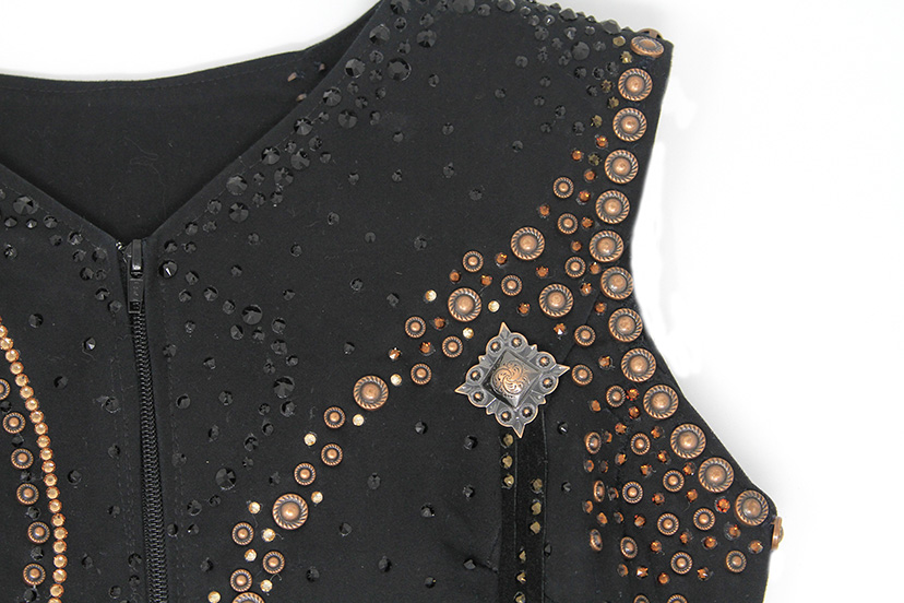 black horse show western vest decorated with copper sequins, nailheads and conchos (Credit: Tara Matsler)