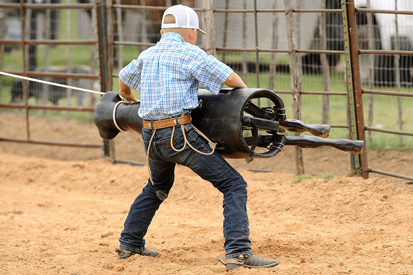 young roper flanks a Perfect Calf roping dummy