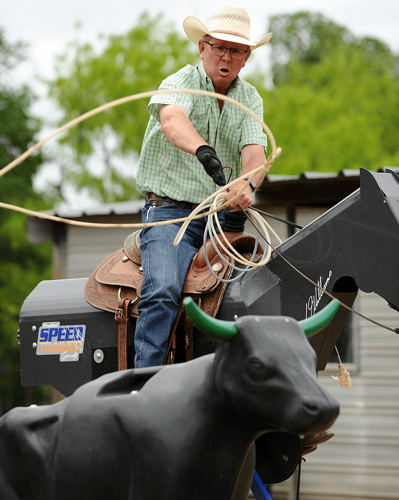 Justin Parrish rides Speed Rider mechanical horse while roping the Smarty XTreme roping dummy