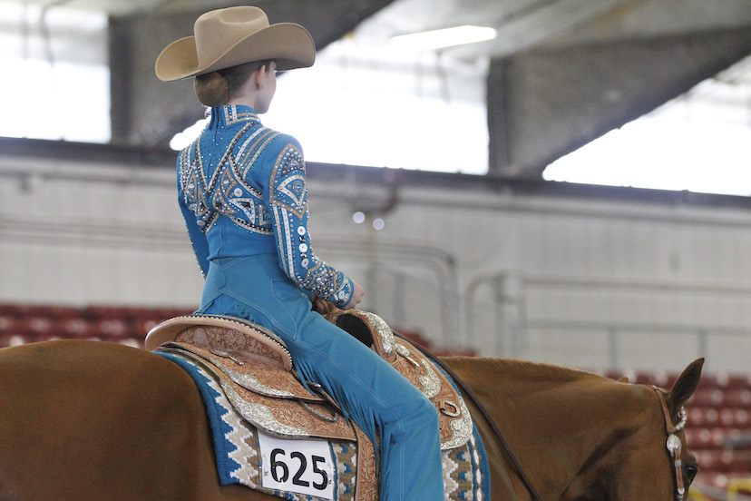 youth horsemanship exhibitor wears blue chaps and shirt (Credit: Journal)