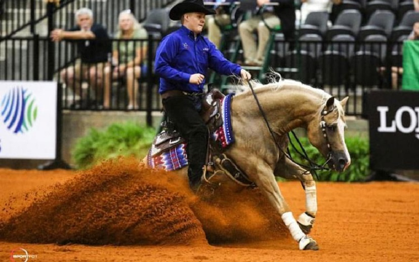 Cade McCutcheon performs a sliding stop on palomino stallion Custom Made Gun at the 2018 World Equestrian Games