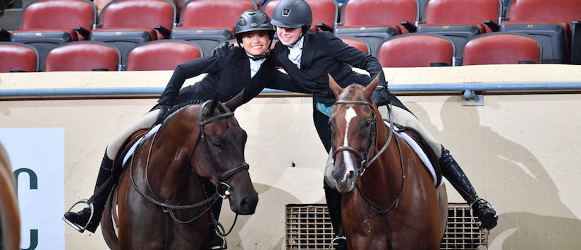 horseback English competitors hug each other in congratulations