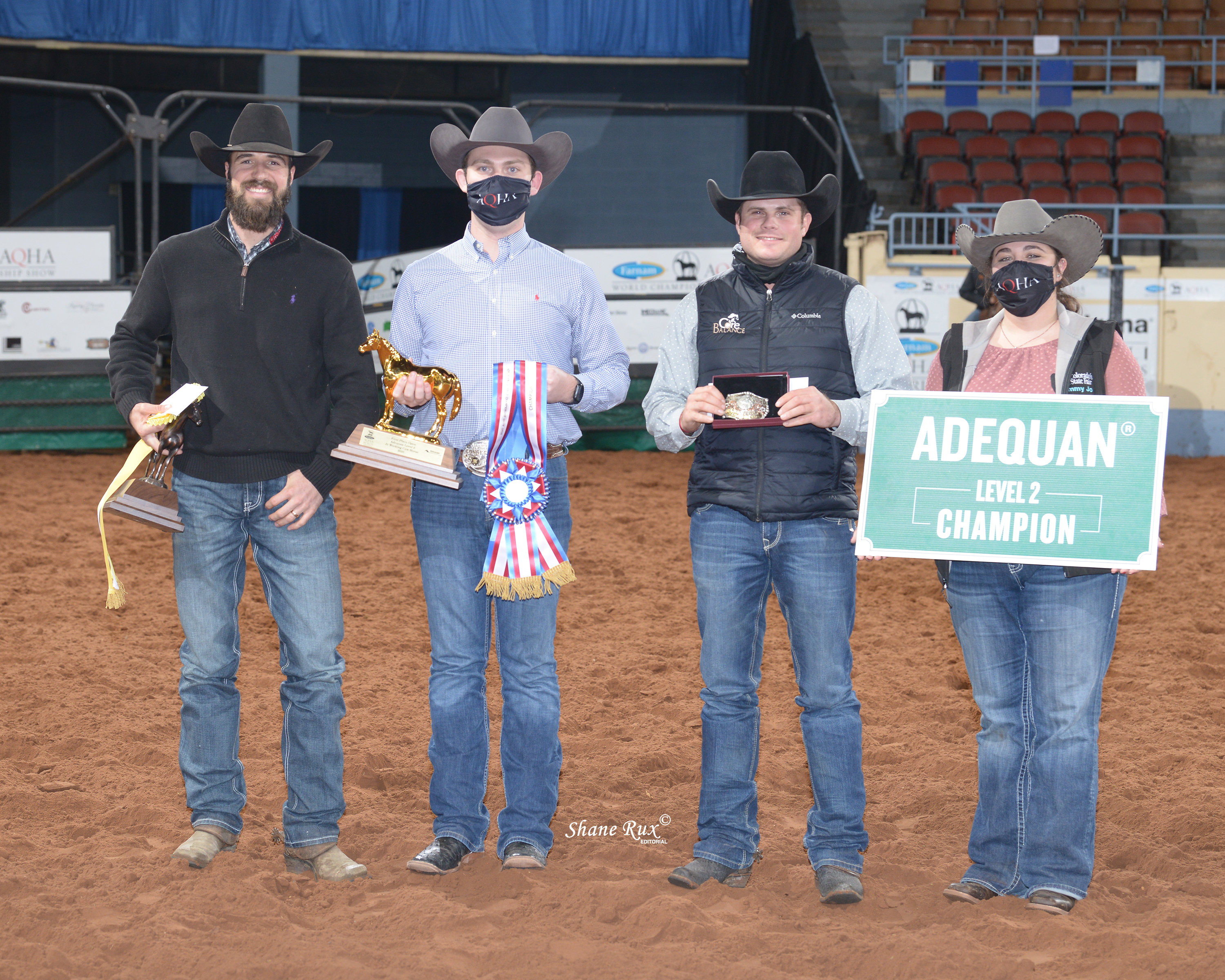 The connections of GA Dual R Starlight accept the world championship prizes after a win in Level 2 junior working cow horse.