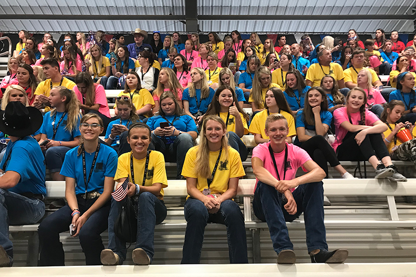 Youth Excellence Seminar attendees sit in stands at American Quarter Horse Youth World Cup