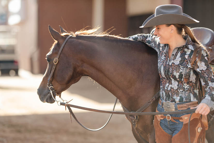 ranch riding exhibitor hugs horse (Credit: AQHA)