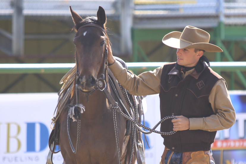 Luke Neubert relaxes with a colt during the 2012 Horseman's Reunion event (Credit: AQHA)